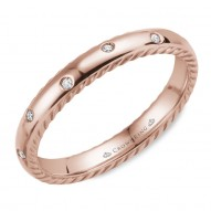 CrownRing wedding band in rose gold featuring 12 round diamonds and rope detailing on the sides.