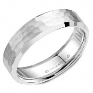 CrownRing A hammered white gold wedding band with beveled edges.
