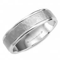 CrownRing A hammered white gold wedding band with polished edges.