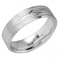 CrownRing white gold wedding band with a carved patterned center and milgrain detailing.