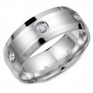 CrownRing white gold wedding band with beveled edges and brushed center featuring six diamonds in a bezel setting.